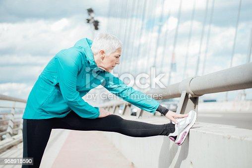 istock Mature woman exercising 958918590