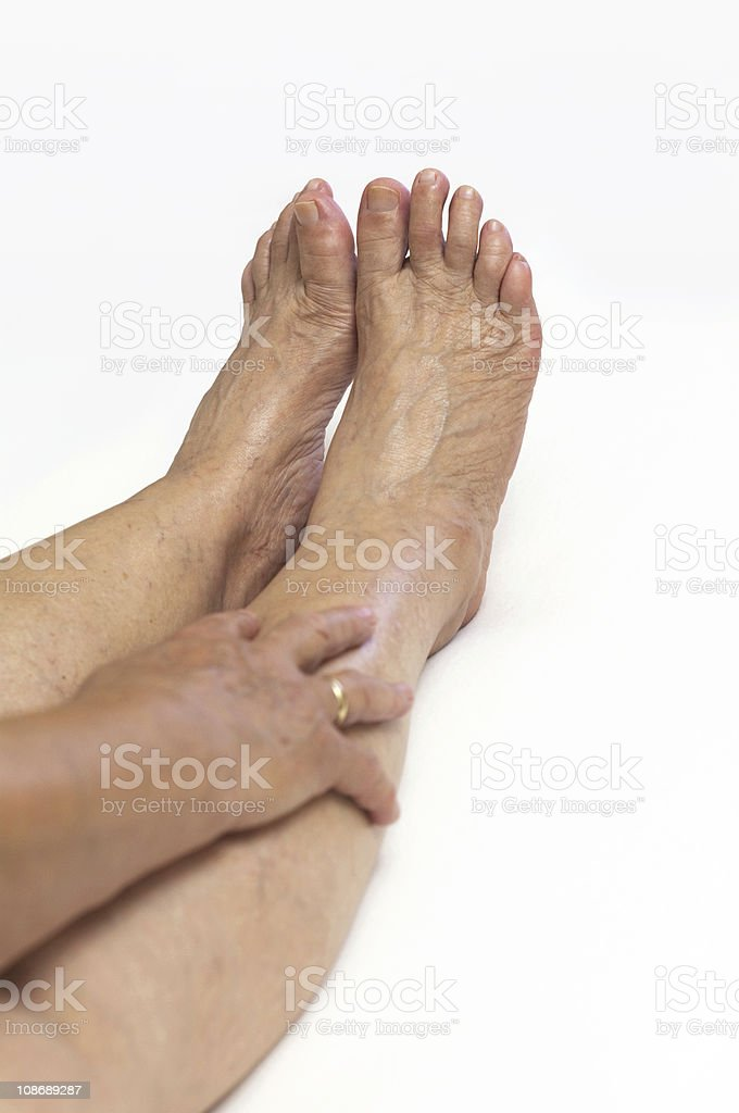 Mature woman feet royalty-free stock photo