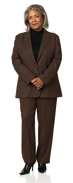 Mature Woman Full Length Portrait In Brown Suit stock photo