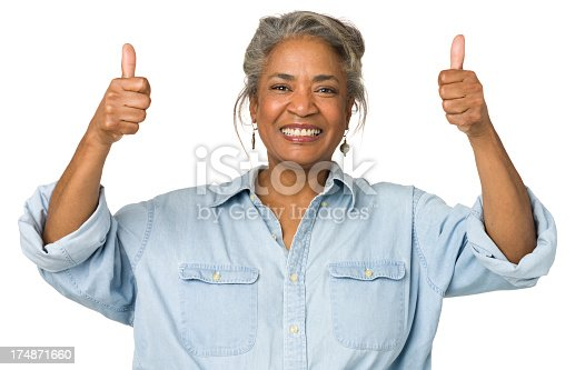 1173001813istockphoto Mature Woman Gives Two Thumbs Up 174871660