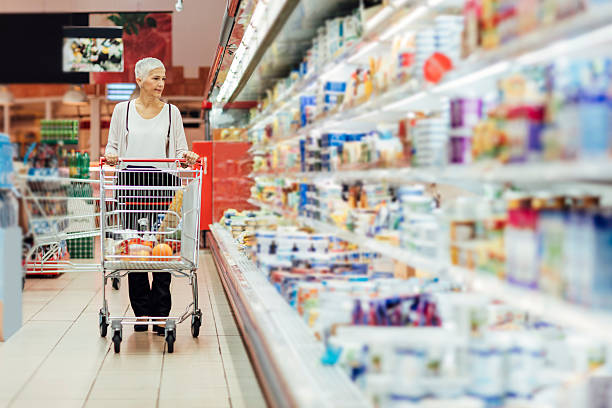 Mature Woman Groceries Shopping. - Photo