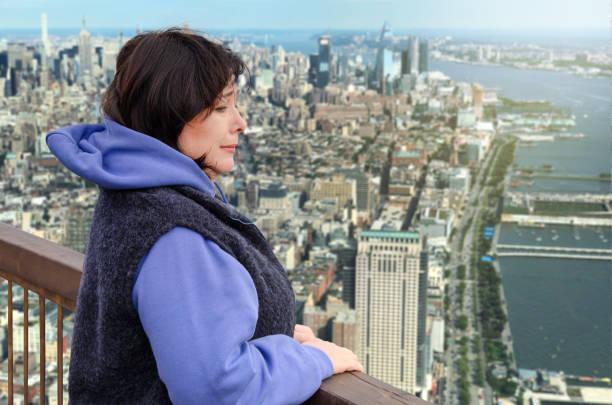 Mature woman has acrophobia stock photo
