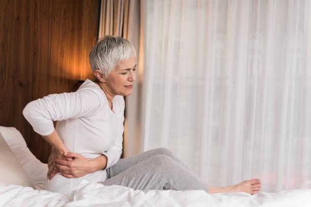 Mature woman having back pain stock photo