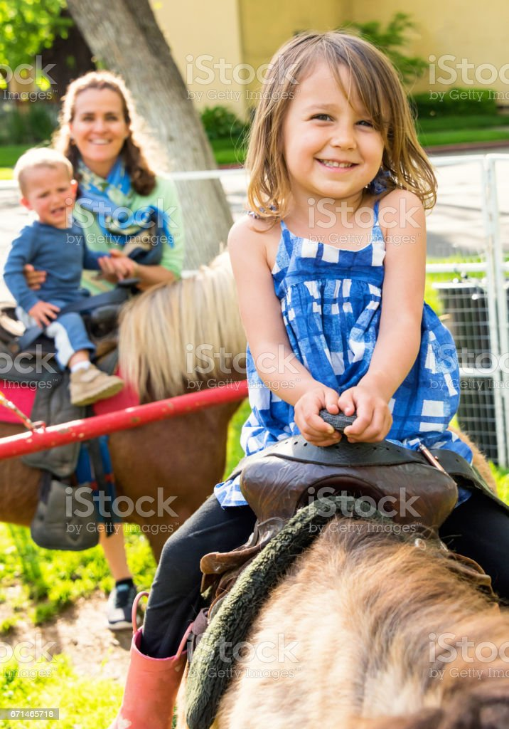 Mature woman having fun with her children stock photo