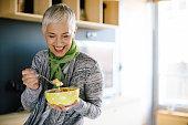 Mature woman having healthy breakfast
