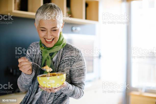 Mature woman having healthy breakfast picture id904876956?b=1&k=6&m=904876956&s=612x612&h=u1rnszrozzy5rlt gp1f0qtyre44c6s5cjrhv4ktae8=