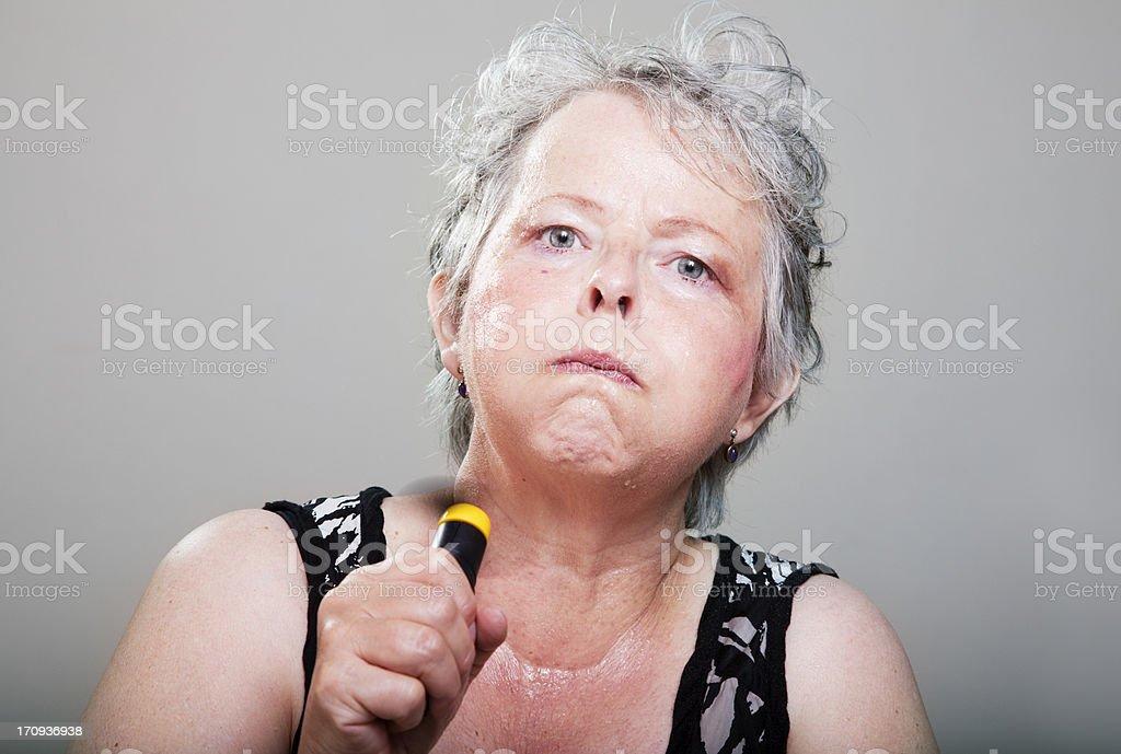 mature woman having hot flash royalty-free stock photo
