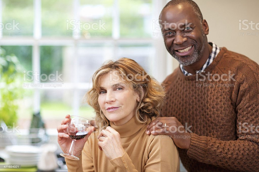 mature woman having massage from her husband royalty-free stock photo