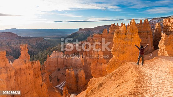 mature asian woman hiking Bryce Canyon National Park. Thor's hammer