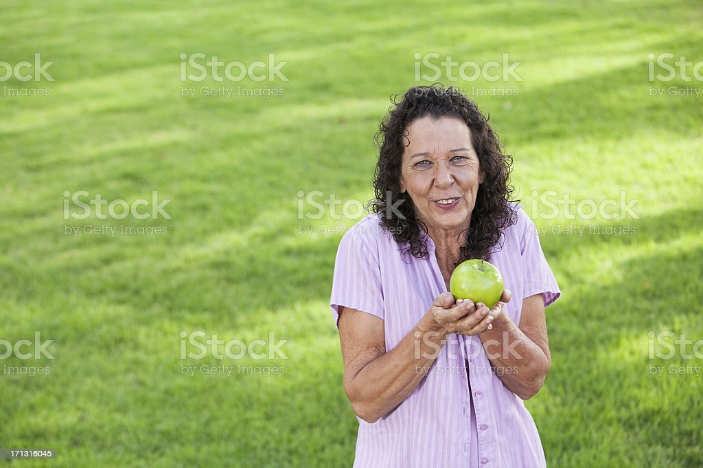 Mature woman holding apple stock photo