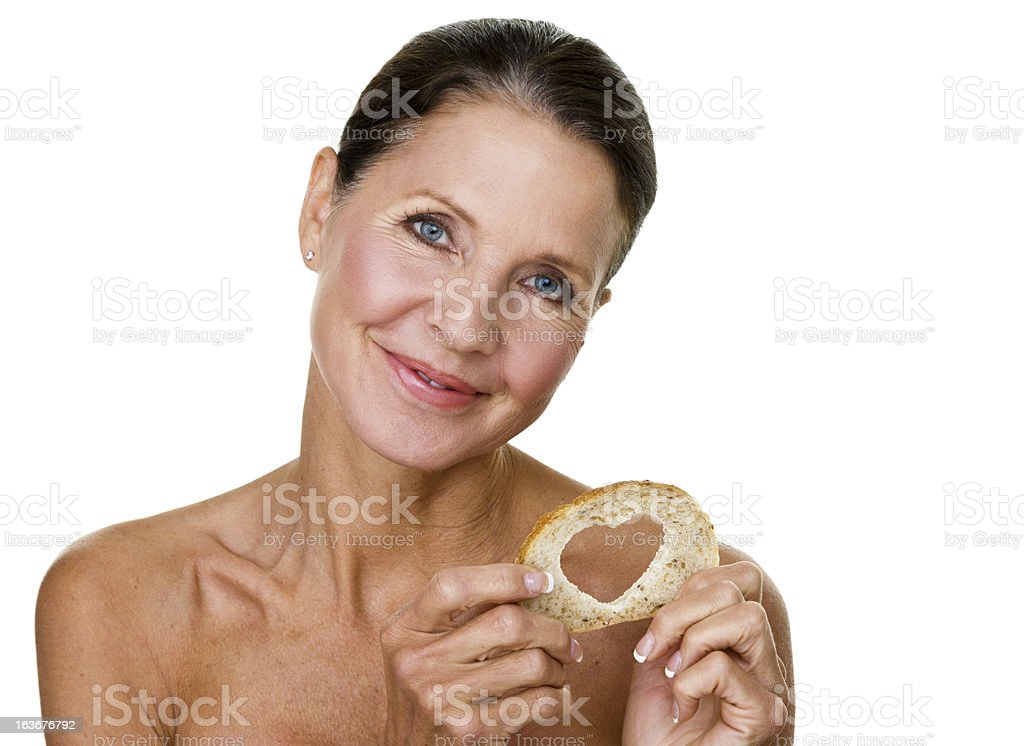 Mature woman holding bread royalty-free stock photo