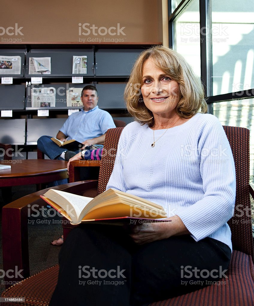 Mature Woman in a Library royalty-free stock photo