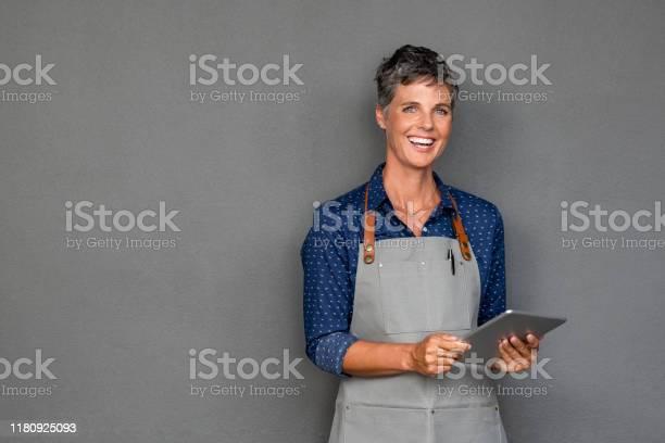 Mature woman in apron holding digital tablet picture id1180925093?b=1&k=6&m=1180925093&s=612x612&h=jisqhzxk8fidjmg5qaxrbynpxhpxl57pdowhlgfxub4=