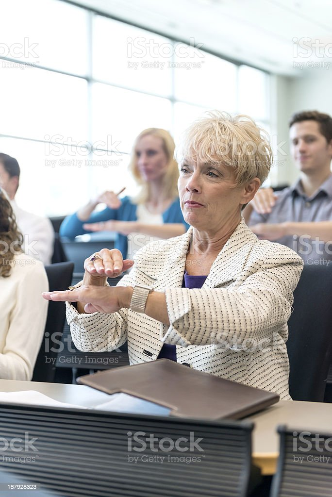 Mature woman in ASL Class stock photo