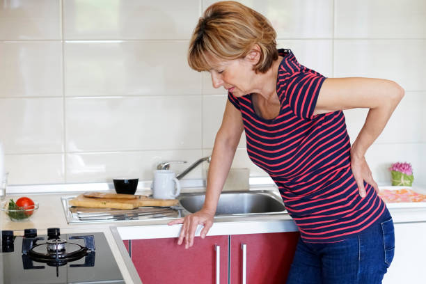 Mature woman in backache stock photo