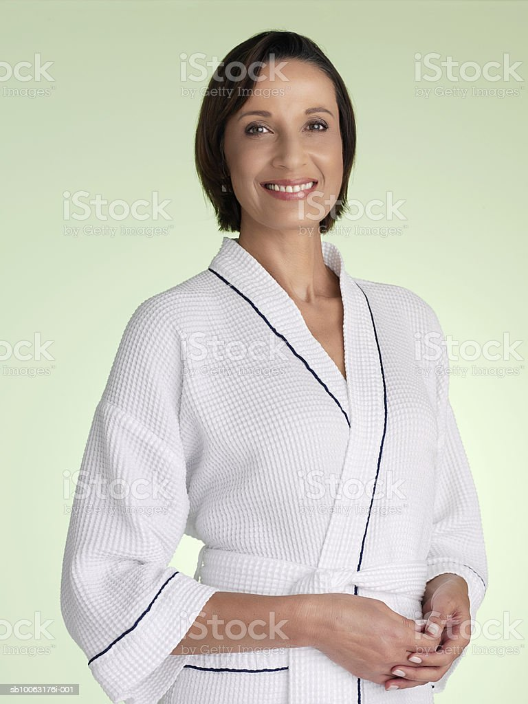Mature woman in bathrobe, smiling, portrait royalty-free stock photo