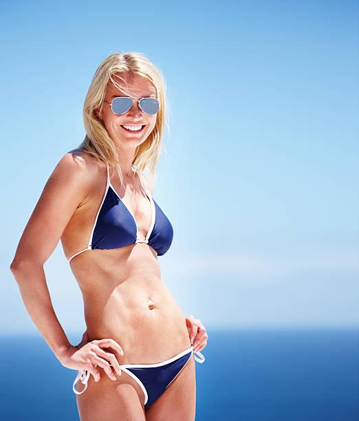 Mature woman in bikini Beautiful mature woman wearing a bikini smiling middle aged women in bikinis stock pictures, royalty-free photos & images