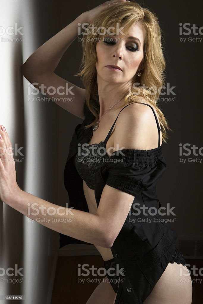 Mature woman in black lingerie. royalty-free stock photo