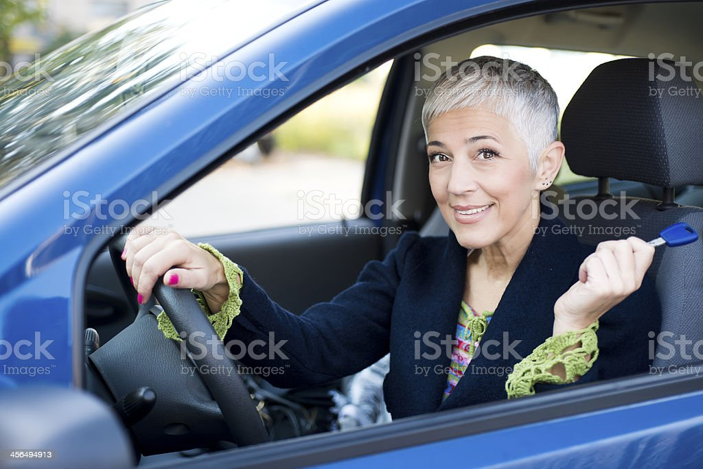 Mature woman in car royalty-free stock photo