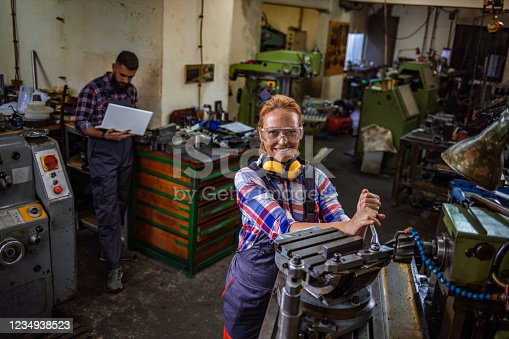 Beautiful mature woman working in engineering industry smiling while looking at the camera.