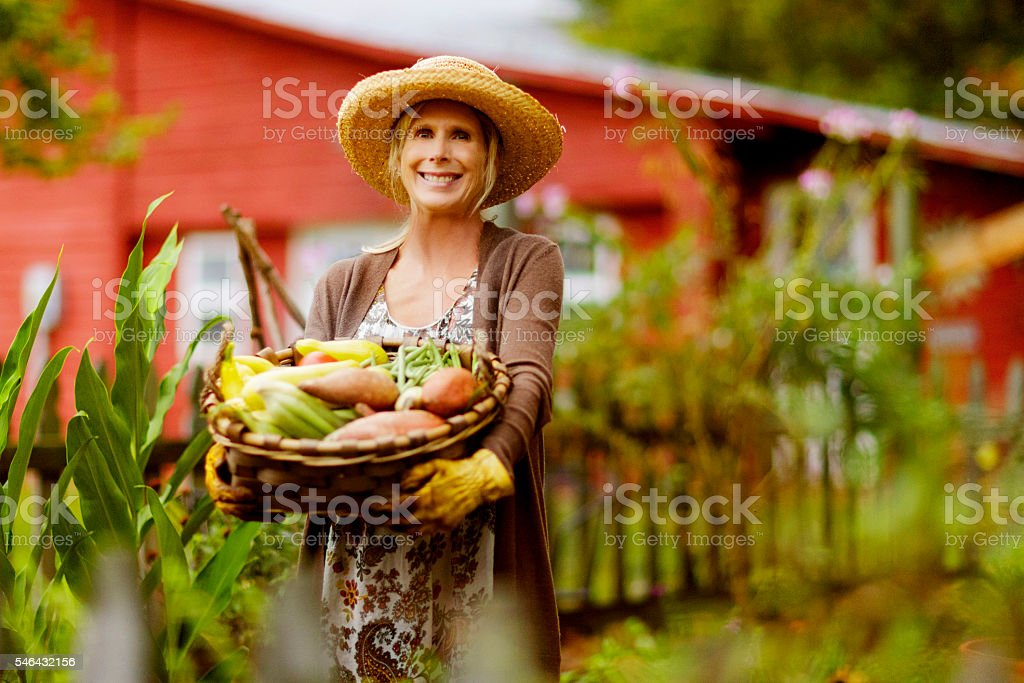 Mature Woman in Garden stock photo