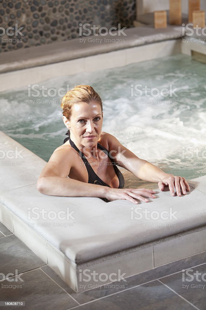 Mature woman in jacuzzi royalty-free stock photo