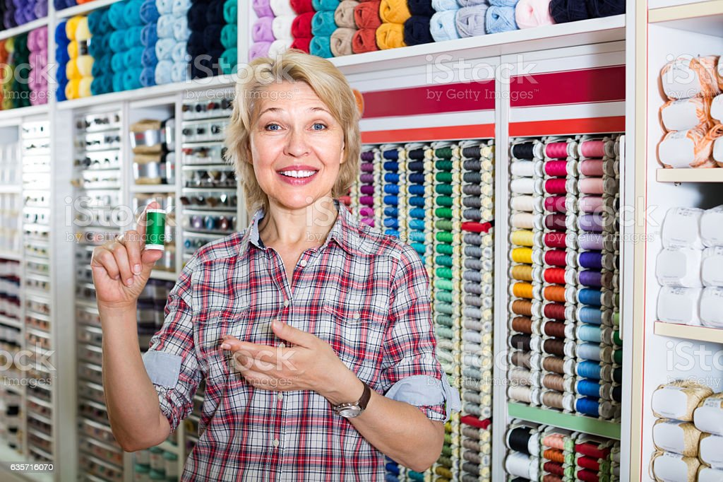 mature woman in sewing store royalty-free stock photo