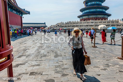 Mature woman in the Circular Mound Altar at the Temple of Heaven complex, an Imperial Sacrificial Altar in Beijing. UNESCO World Heritage,Nikon D3x