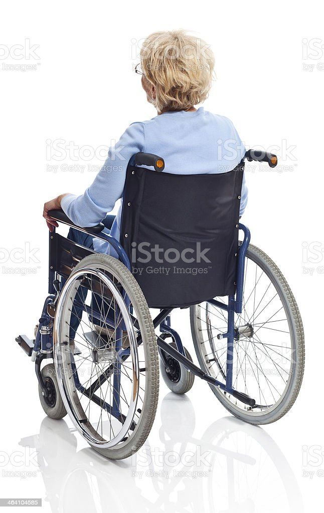 Mature woman in wheelchair Back view of senior woman sitting in wheelchair. Studio shot on white background. 60-69 Years Stock Photo