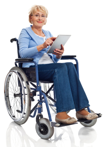 Mature Woman In Wheelchair With Digital Tablet Stock Photo - Download Image Now