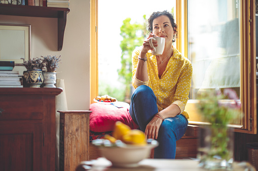 istock Mature woman is having the morning coffee at home 1038700970
