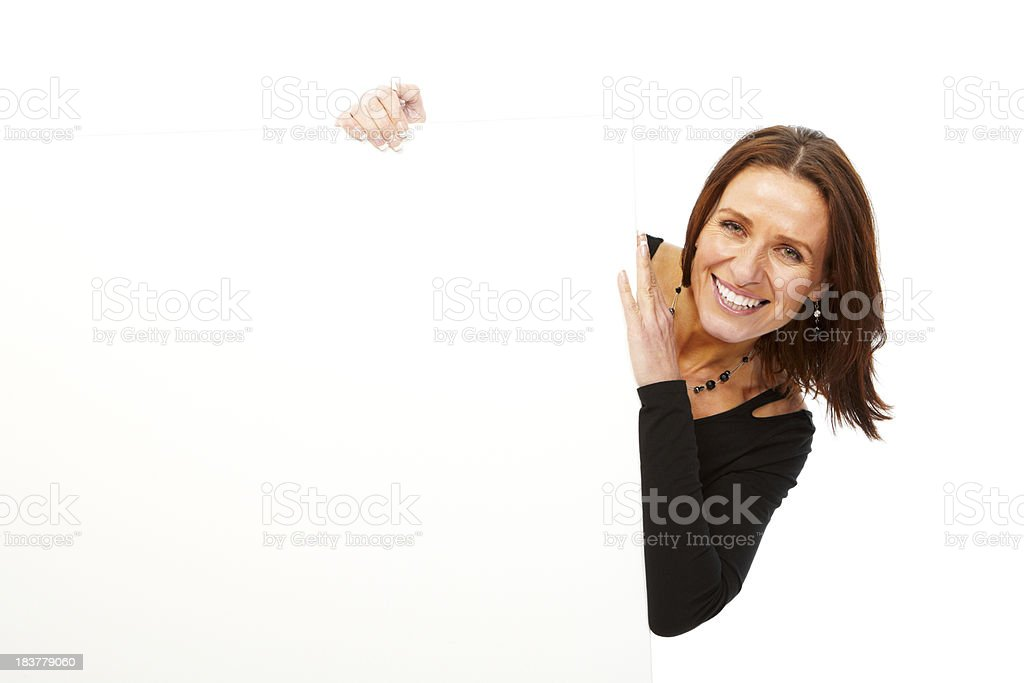 Mature woman isolated on white background holding board stock photo