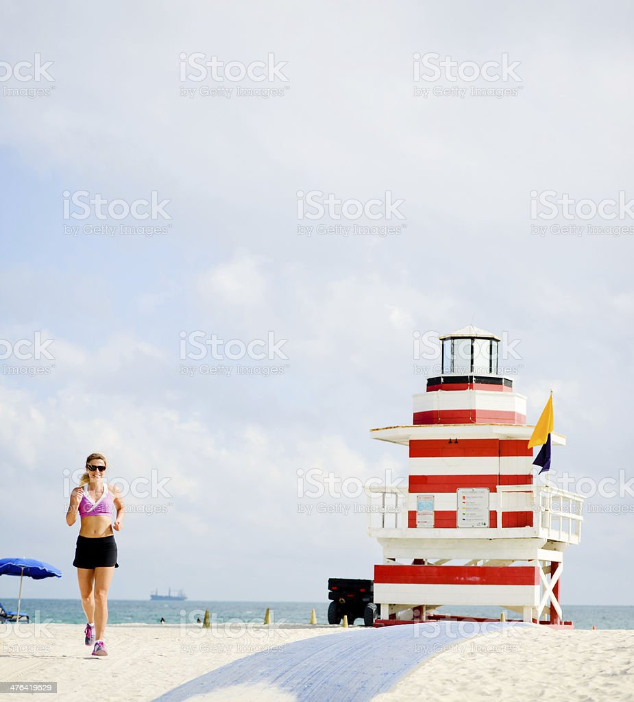 Mature Woman Jogging On the Beach royalty-free stock photo