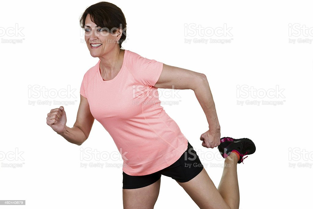 Mature woman jogging royalty-free stock photo