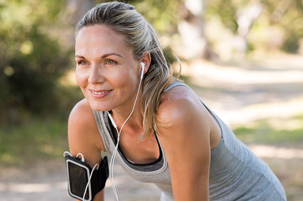 Mature woman jogging stock photo