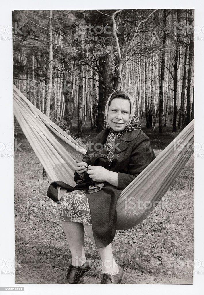 Mature woman knitting outdoors royalty-free stock photo