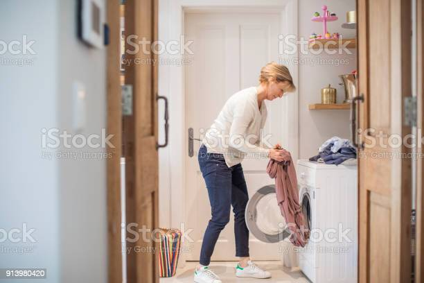 Mature woman loading clothes in washing machine picture id913980420?b=1&k=6&m=913980420&s=612x612&h=igcqq meajpi52vc7flynmpcj7lvk69fs nqjjzbsny=