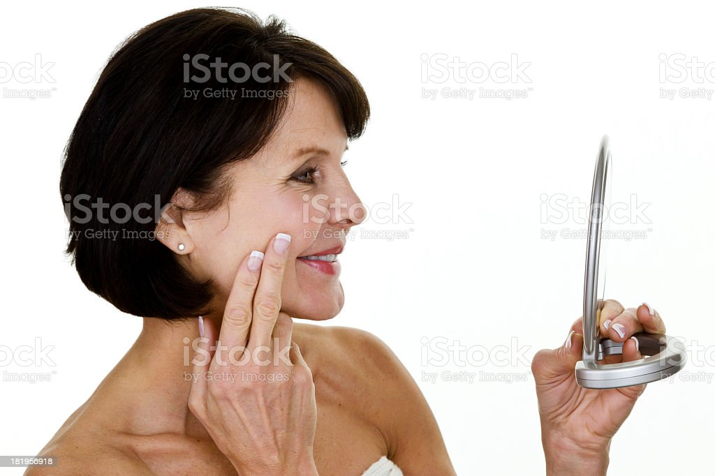 Mature woman looking at mirror royalty-free stock photo
