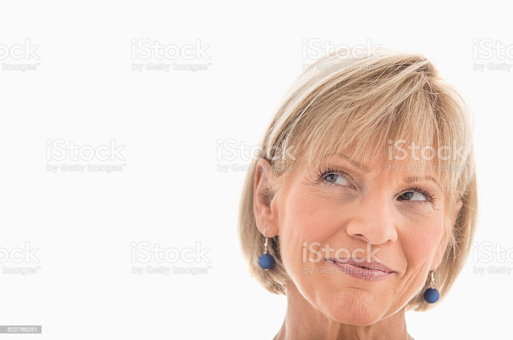 Mature Woman Looking Away Over White Background stock photo