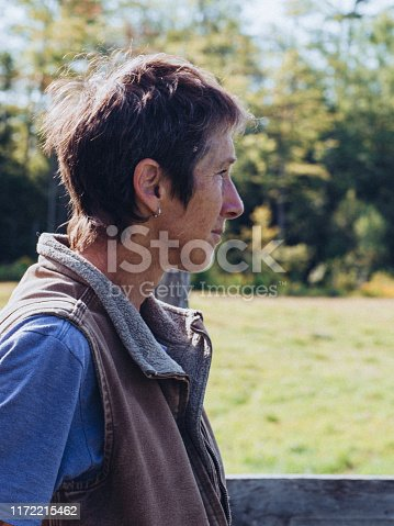 Mature Woman Looks Out in Peaceful Mood