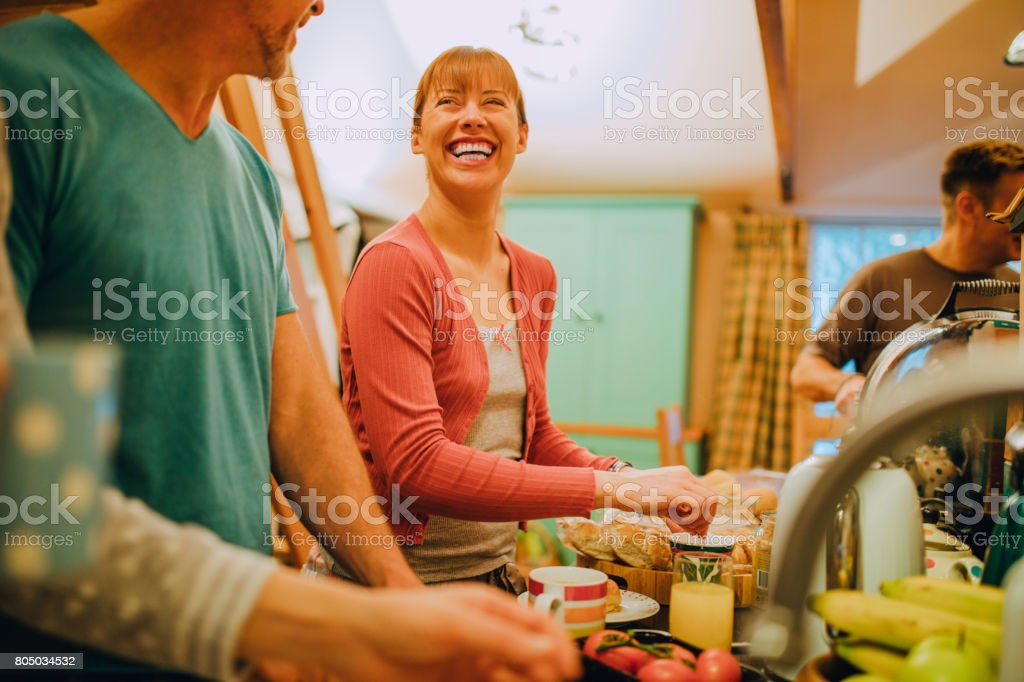 Mature Woman Making Breakfast with Friends stock photo