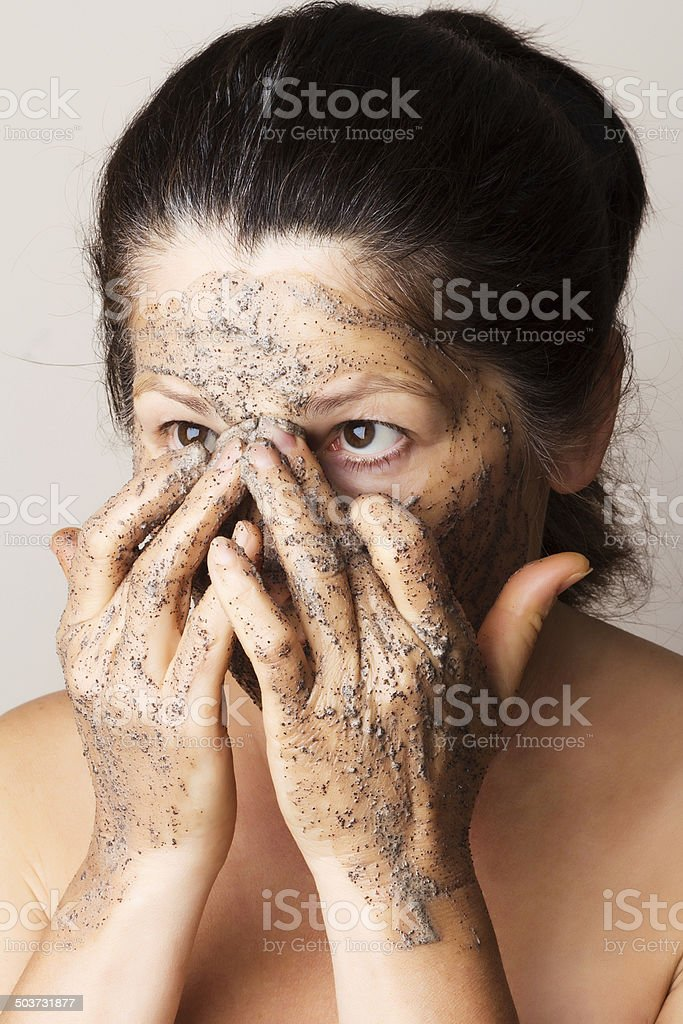 Mature woman making cosmetic mask stock photo