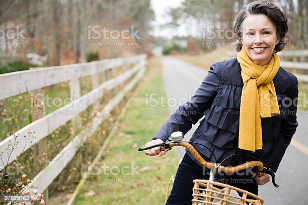 Photo of Mature woman on a bicycle