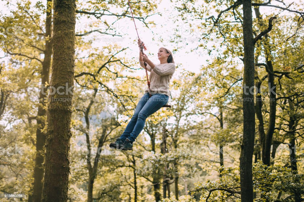 Mature Woman on a Rope Swing