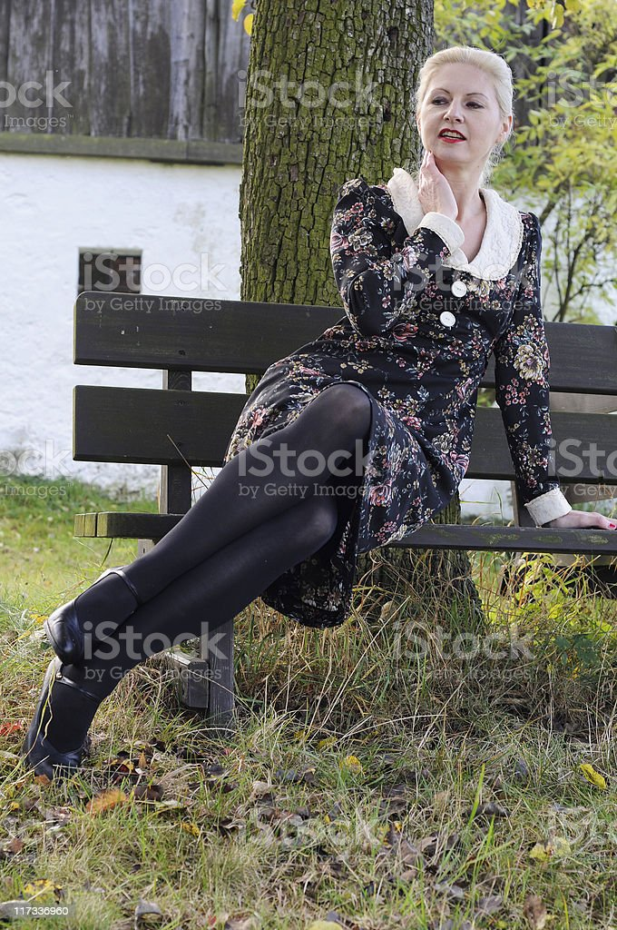 Mature Woman on Bench in Nature royalty-free stock photo