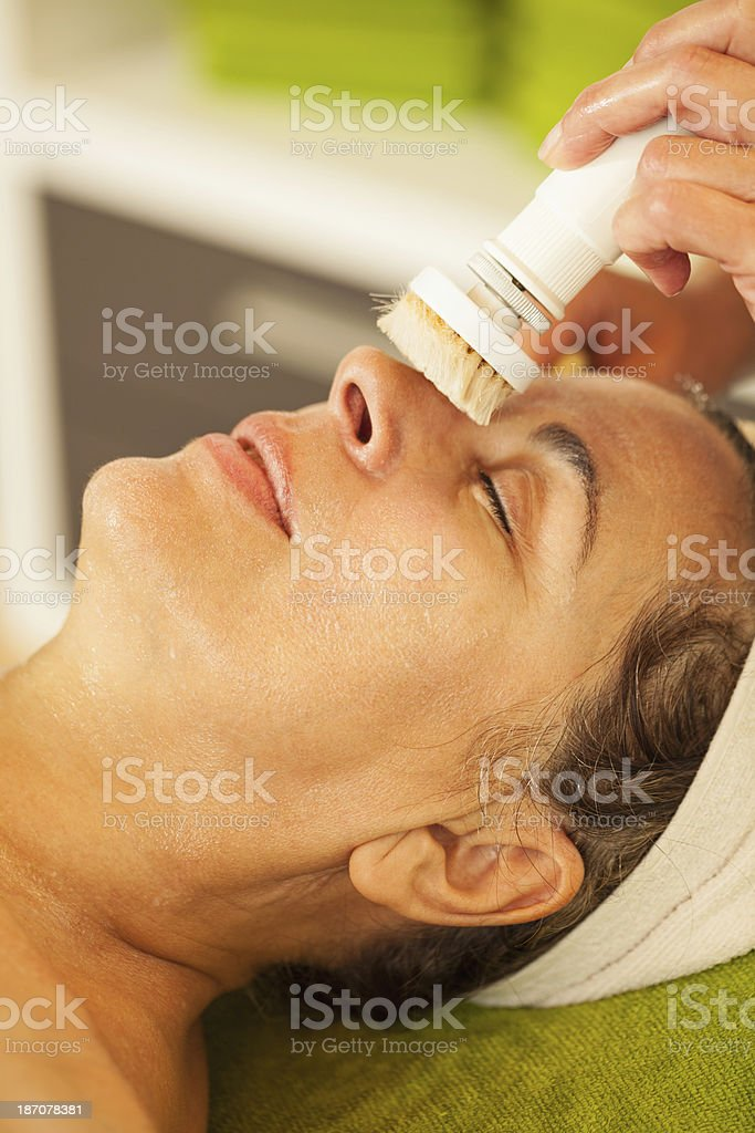 Mature woman on cosmetic treatment royalty-free stock photo