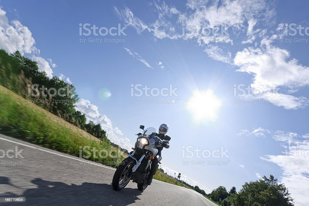 mature woman on motorcycle stock photo
