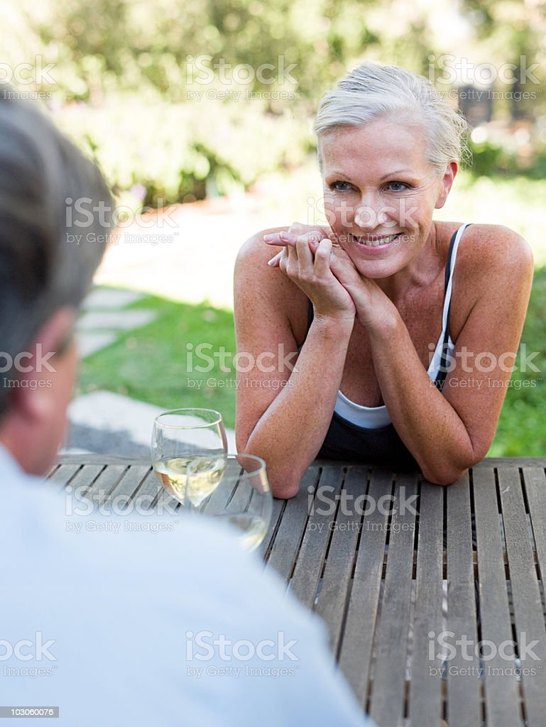 Mature woman outdoors with wine royalty-free stock photo
