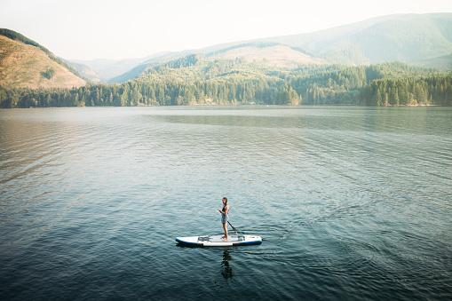 istock Mature Woman Paddleboarding 843469016