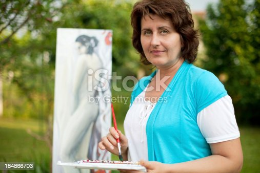 585509074 istock photo Mature woman painting outdoors. 184866703